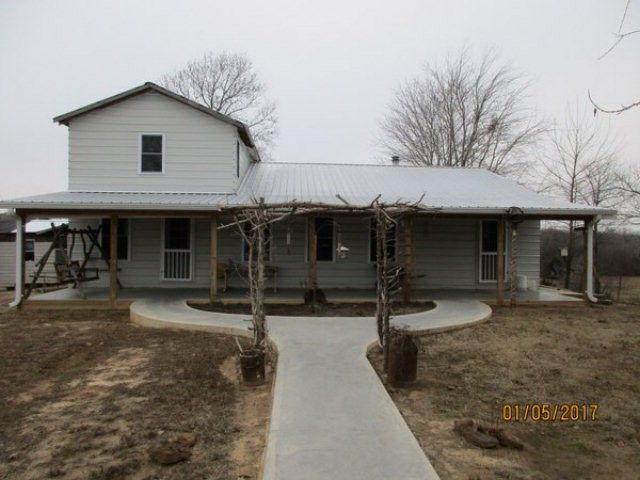 This can be the farm for you! Extra large open living space with room to subdivide if needed. This home does not have electric wiring or closets in upstairs bedrooms. Wonderful garden space! Fencing for animals. This home was REMODELED w/new roof, added on, flooring, walls, etc. New concrete front porch with nice sidewalk. Custom made oak kitchen cabinets.Lots of outbuildings for horses, chickens, etc.There is also a 2nd house on property that could be remodeled. Will not go FHA in…