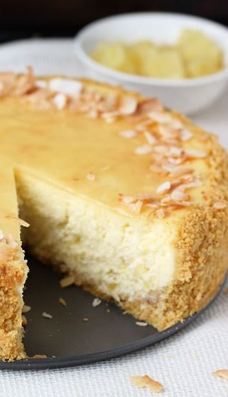 Pina Colada Cheesecake - A rich and creamy cheesecake filling infused with cream of coconut and pineapple chunks makes this piña colada cheesecake a pure delight that will transport you to the tropics in no time!