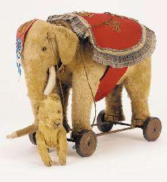 rare Schuco elephant on wheels http://images.google.com.au/imgres?q=elephant+on+wheels=10=en=813=751=isch=k8U8vIxy-i7YJM:=http://www.christies.com/lotFinder/lot_details.aspx%3FintObjectID%3D2044526=CHqGhpDqal91SM=http://www.christies.com/lotfinderimages/d20445/d2044526r.jpg=235=256=U0EPUIayB-3ymAWk_IGACw=1=hc=119=255=2135=204=188=100=90=101310537409347512763=3=136=145