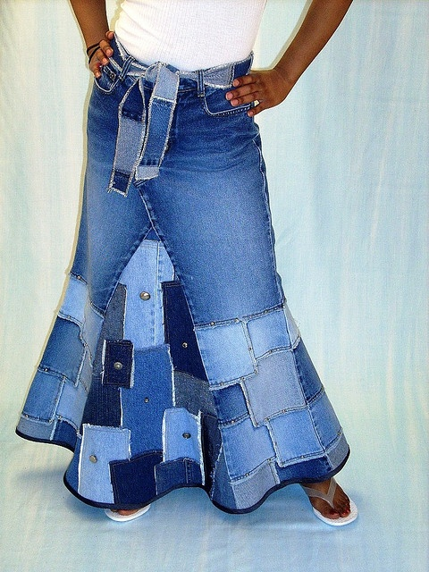 my home made jean skirt never looked this cute. might have to give it another try.   This is a skirt that was made from a pair of old jeans. The center panel was made by recycling a collection of various shaded blue jeans.  Really? That's the most hideous thing I've seen...