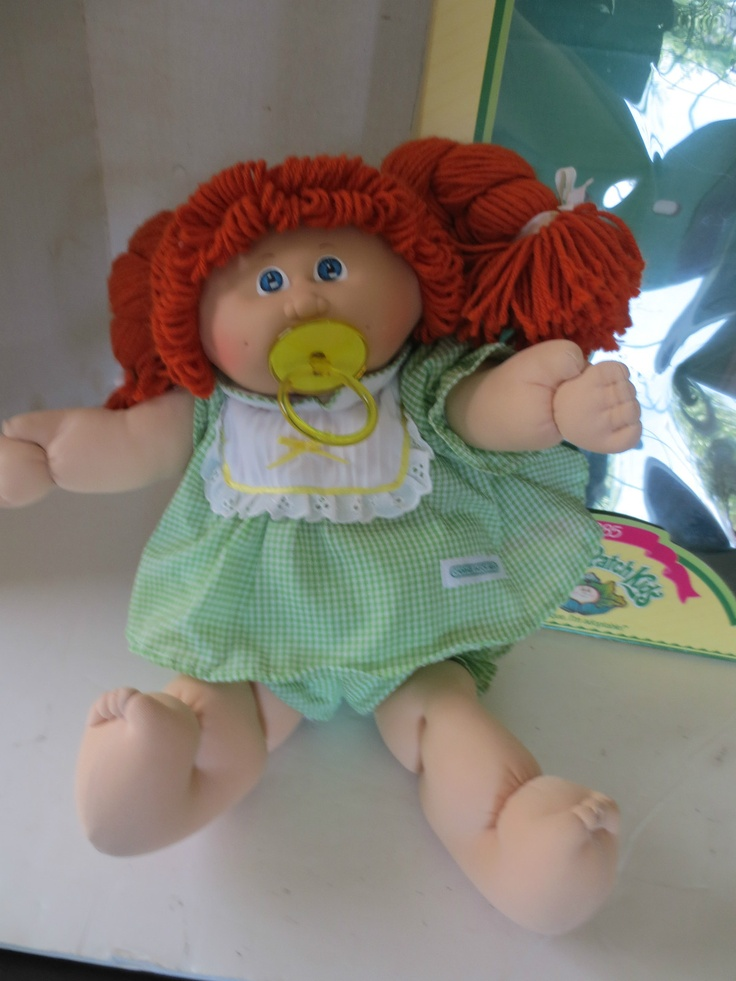 Cabbage Patch Kids - mine looked just like this, but had green eyes. Her name was Regina Florrie!