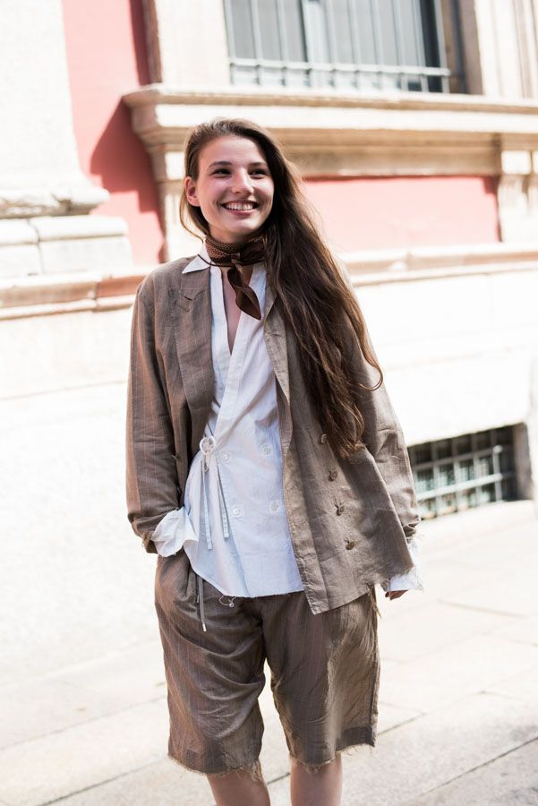Street Style portraits by Ángel Robles. Fashion Photography from Milan Fashion Week.  Woman smiling with a vintage inspired outfit after Missoni show, Milano.