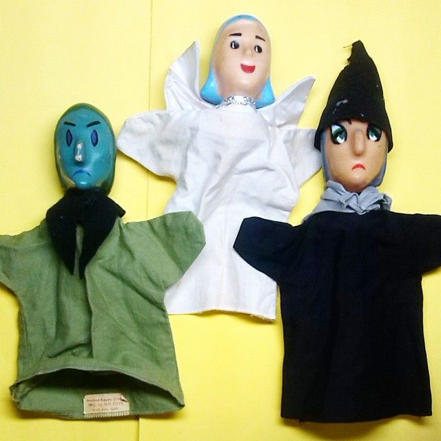 "An angel between 2 witches. The 2 hand puppets on the right came with a Hazelle's puppet - the label with ""Storybook Puppets"" and a 1960 copyright before. The green witch out of the box of puppets that. (They are the puppets that I will let nieces and nephews play with.) According to the label they were ""Mfg. by MPI TOYS / South Gate, Calif."""
