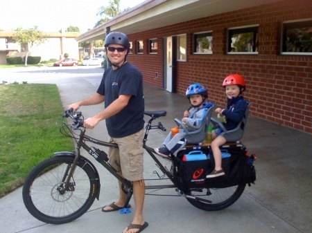 surly big dummy with two kids.