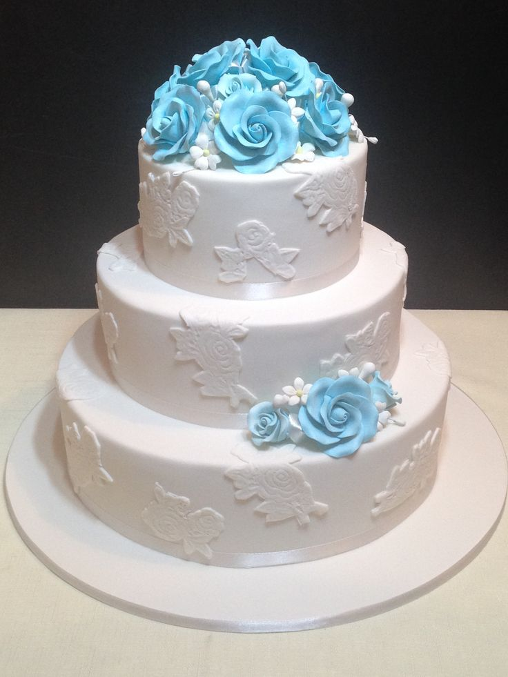 3 tier white with blue roses wedding cake
