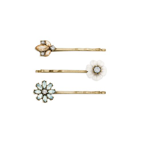 Add a touch of sparkle to your 'do with this stunning hair pin trio! A fresh mix of champagne, serenity blue, clear, + white opal crystals catch the light in a romantic, antique gold setting. Style Tip: Perfect for a sophisticated soirée – or dare we say your wedding day – try topping of an elegant chignon with these florally-yours favorites!