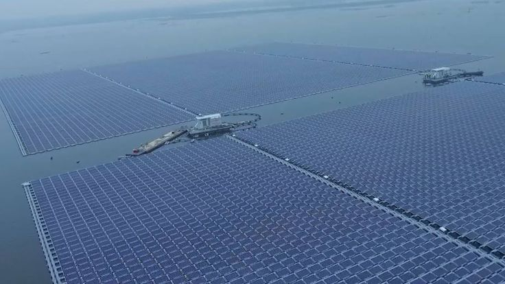 World's largest #floating #solar_farm in E #China The 40-megawatt #power_plant, with 165,000 solar panels, is built on the surface of a lake in east China's Anhui. The lake takes shape as rain water accumulates in a coal mine subsidence area. China plans to make big investment in renewable energy projects and drastically cut carbon emissions. https://www.youtube.com/watch?v=qKpYH5SYUeo