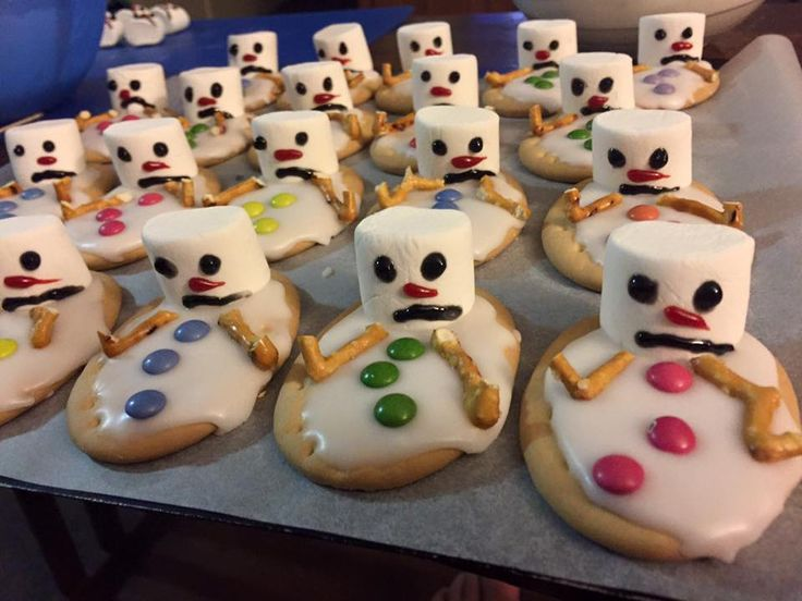 Not a cupcake but lots of fun!!  Melted snowmen biscuits for the kid's Christmas breakup party - arrowroot biscuits topped with white glaze icing, marshmallow snowmen decorated with gel icing, mini m%ms and pretzel arms