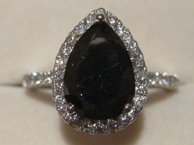 Google Image Result for http://www.pricescope.com/idealbb/files/Diamond%2520Black%25204.1ct%2520Face%2520on_1.JPG