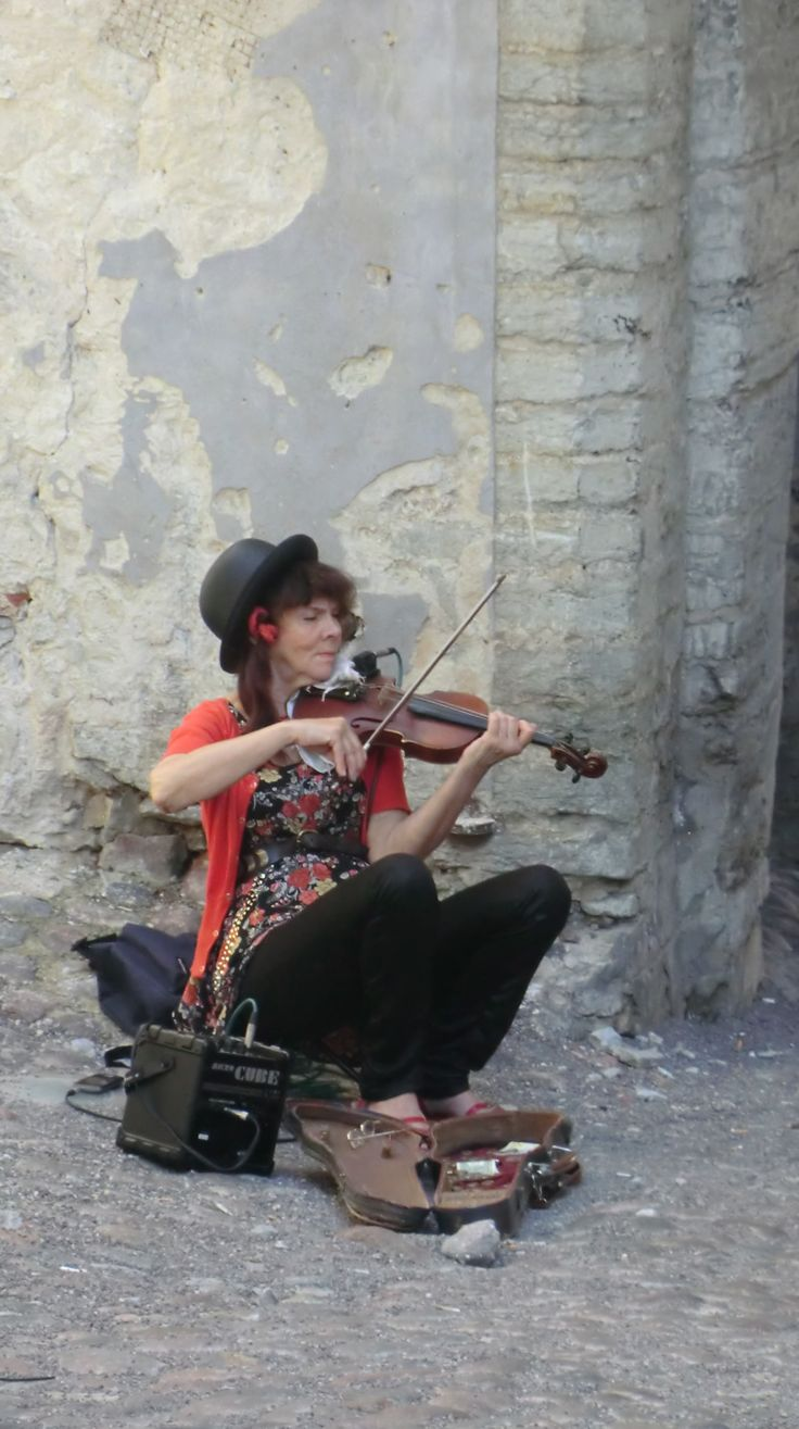 Musician by the castle, Old Tallinn by Julie Sant, July 2015