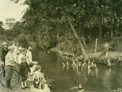 Children swimming and canoeing in the Bronx River, 4 August 1916