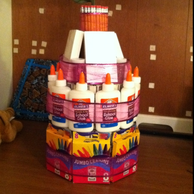 A school supplies cake I made for my best friend's college graduation! She got her degree in elementary Ed so I wanted a gift to go with that! Super fun and easy to make. Use hat boxes as support in center which can be filled with extra supplies, and tape everything on instead of glue so the supplies don't get sticky. You can find all the pieces at the dollar store like I did!