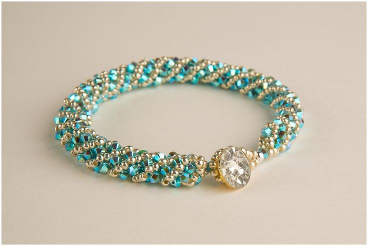 Swarovski spiral bangle with vintage crystal button.