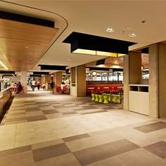 Design by Red Design Group-Destination in feel, intimate pockets cater for individuals, small or large groups – with tiling, furniture, timber screening and lighting creating a warm and inviting escape from clinical surrounds.