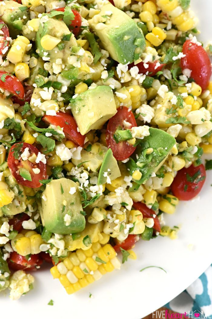 Corn, Tomato, & Avocado Salad ~ an explosion of Tex-Mex flavors and summertime textures, with fresh roasted corn, juicy tomatoes, creamy avocado, minced jalapeño, crumbled cotija cheese, and fresh cilantro in a zippy lime vinaigrette!   FiveHeartHome.com