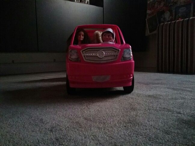 Hazel is chilling out with the barbie dolls in the limousine