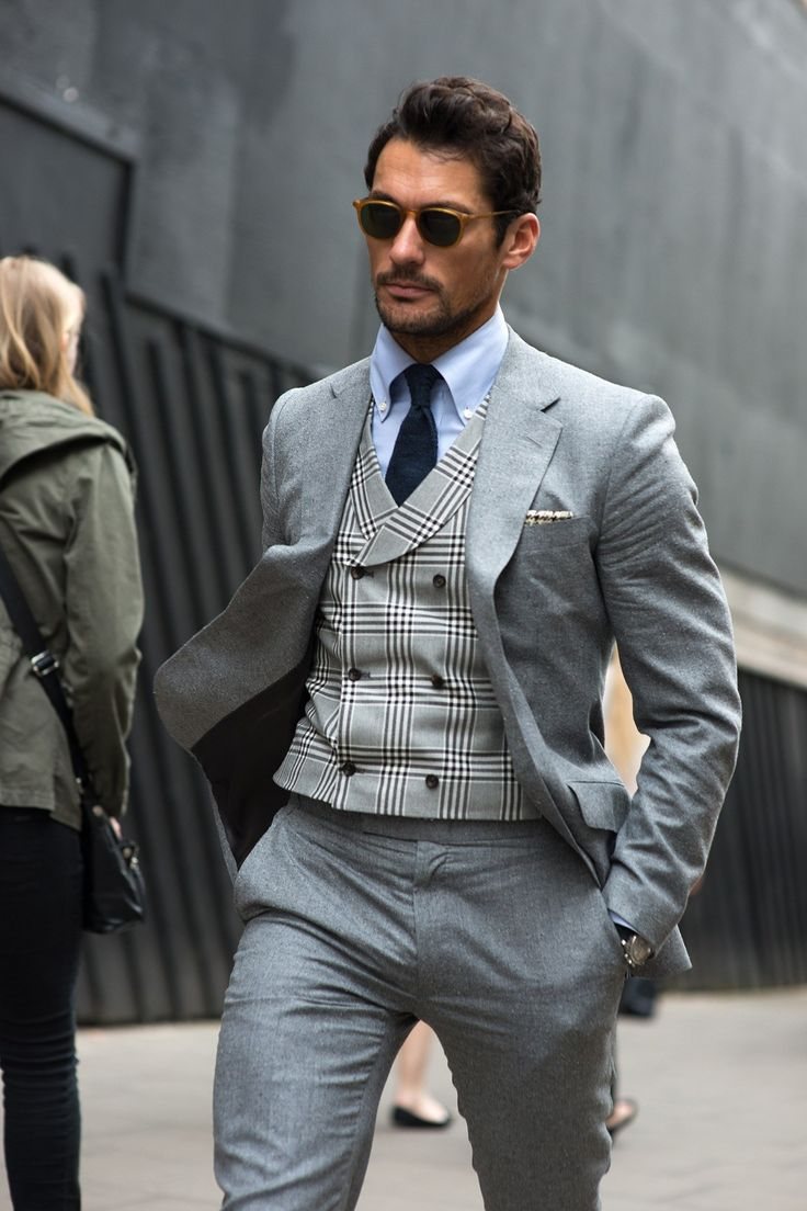 Midgrey suit, greyscale tartan vest, navy necktie, sky shirt, caramel-framed eyeshades