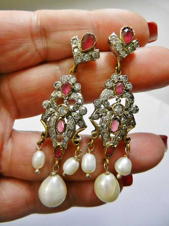 Glitzy dangling cultured pearls and ruby stones  long earrings