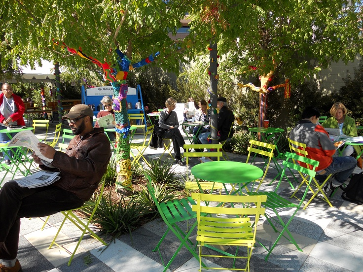 Reading and enjoying the beautiful weather in Klyde Warren Park: The Dallas Morning News Reading & Games Room