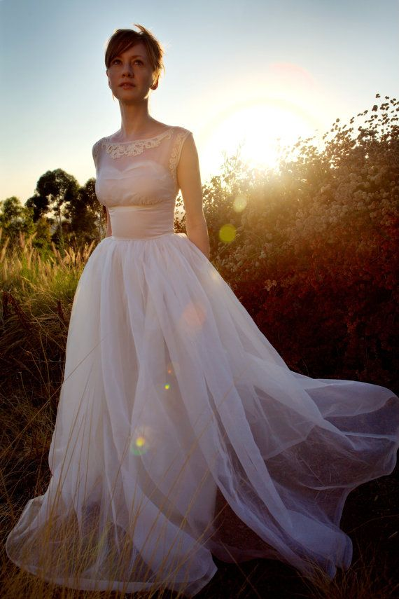 Love this look, so Audrey! Dress: The Violeteer Throwback Thursday: Vintage Bridal Gowns for Today's Bride - Wedding Party