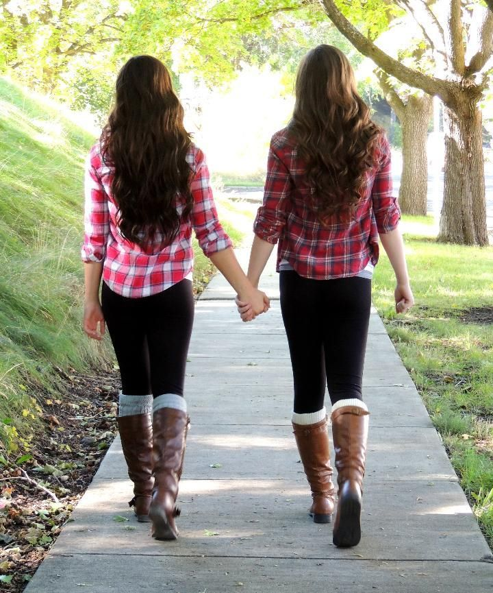 _photoshoot in the fall, both wearing plaid shirts (close to matching if not matching), denim skirts, and boots