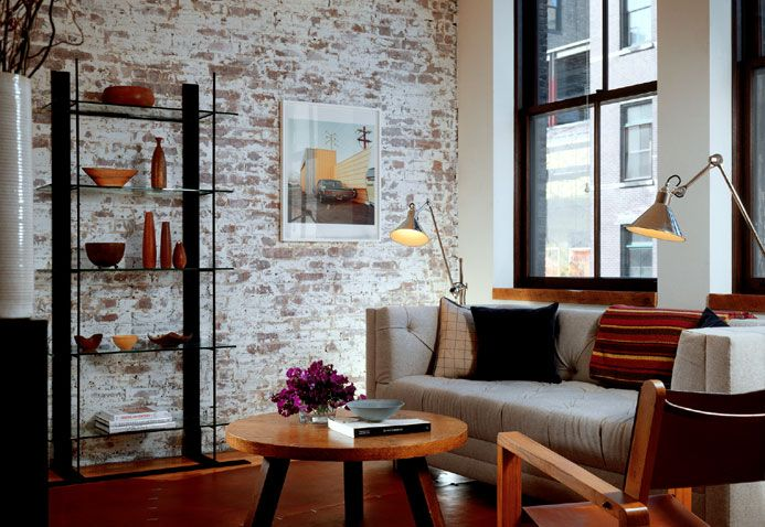 brick accent wall is the best part of the room.