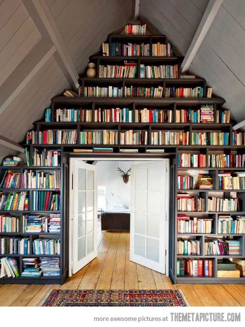 Attic book shelf; You could never do this with Kindles. Books as decorations. The a-frame is accentuated and the French doors open the space and make it one.