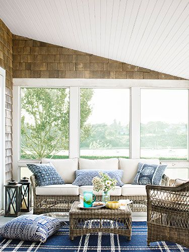 Talk about a room with a view! A Frontgate wicker set overlooks Cape Cod's Little Mill Pond in this sunroom.