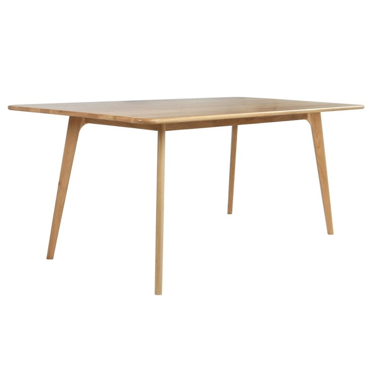A light coloured, sleek designed dining table will provide the perfect foil for your colour splash