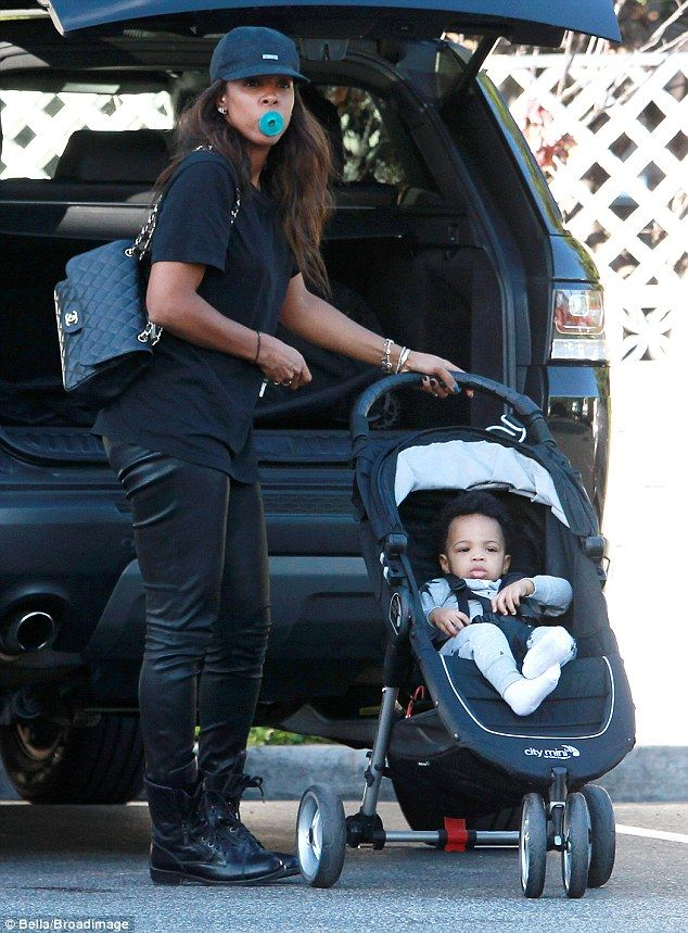 Suck it up: Kelly Rowland made sure her one-year-old tot Titan didn't drop his blue pacifi...
