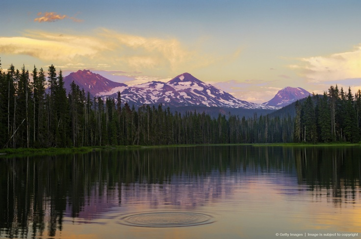 Oregon, Cascade Mountains, Scott Lake and Three Sisters mountain peaks, Sunset light.