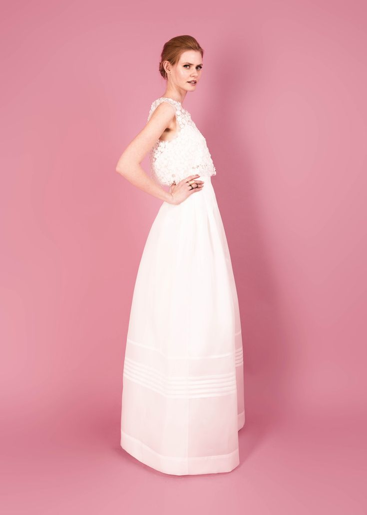 Modern wedding dress for the contemporary bride. Sophia top, Hollie skirt. 3D flower top with scalloped edge. Structured silk organza skirt with pleated high waist.
