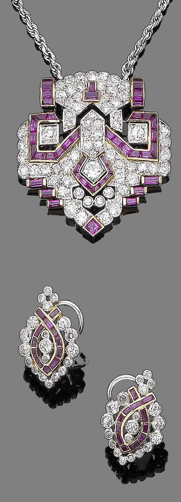 A ruby and diamond pendant necklace and earring suite. Of geometric design, set throughout with cushion-shaped, single and old brilliant-cut diamonds, highlighted by courses of calibré-cut rubies, to a rope-link chain, accompanied by a pair of earrings of similar design, diamonds approx. 4.60cts total, lengths: pendant 3.5cm, chain 41.0cm, earring 2.1cm.