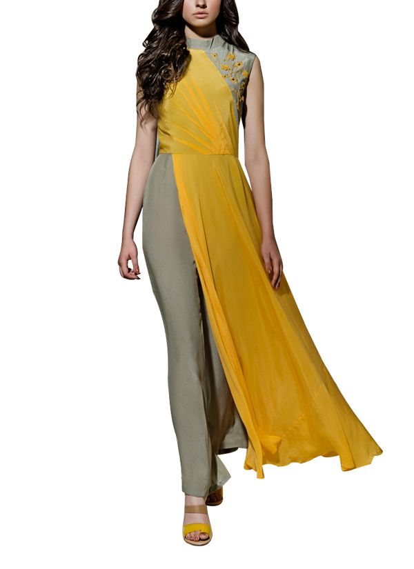 Kanelle brings to you a smart jumpsuit that so versatile that it is perfect for work and play! The jumpsuit is well tailored and fitted, with hand embroidered detailing on the bodice. The highlight of the grey jumpsuit is the mustard drape that begins at the bodice and runs along one side, all through till the ankles. Wear it with a pair of high heels and a beautiful cuff for a smart and sassy look.