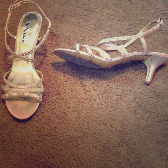 Low heel dress shoes Rhinestones cream color worn once to prom. Placed duct tape on bottom, they were super slippery w/ out. Touch of nina Shoes Heels