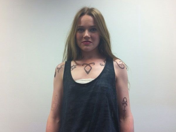 Jemima West shows off her Shadowhunter runes on the set of TMI: COB