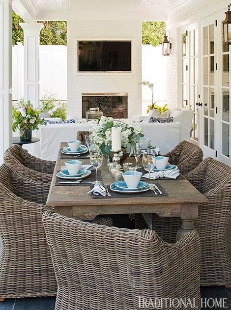 great table and wicker chairs.  But slipcovered furniture outside...?