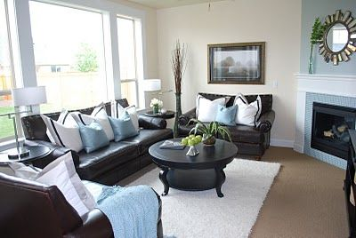 brown couch with blue and white