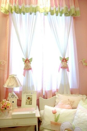 Wouldn't a little girl be charmed by this sweet window treatment? Sheer white curtains are gathered at the center by angels dressed to match the valance. More ideas at mamasmiracle.com.