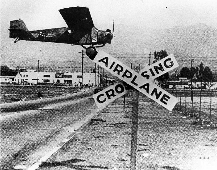 "Here's a sign we'd love to get: ""Airplane Crossing"" sign at Grand Central Airport in Glendale in 1930. Source: Glendale Library Archives"