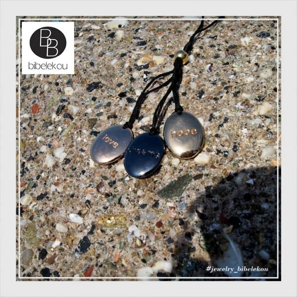 Fashionable pebble necklace with love, hope messages. Spring Summer 2015