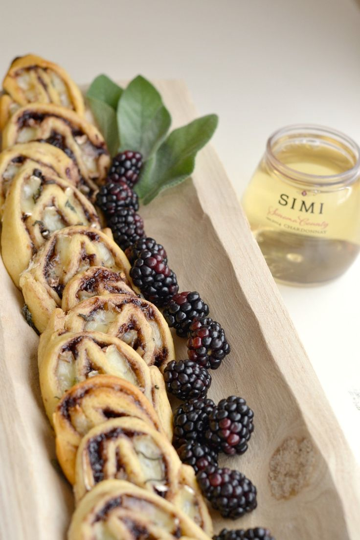 """Msg 4 21+ This easy brie + blackberry pinwheel appetizer only requires four ingredients! It pairs perfectly with wine, and Simi's stacked wine 4-packs allow you to take your party """"on the go."""" #sharewine #ad via @goodinthesimple"""