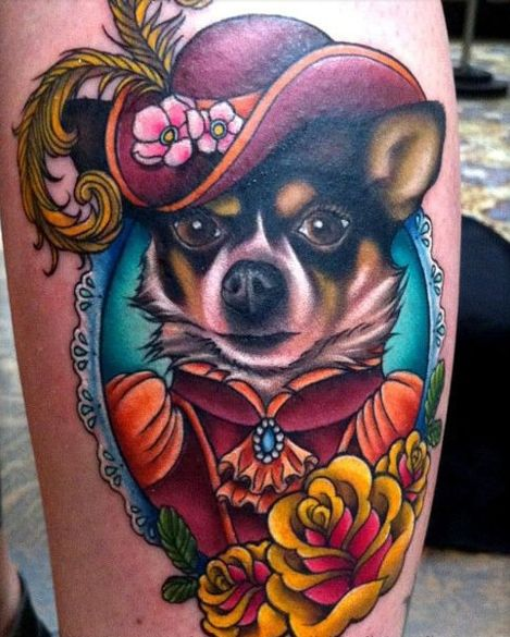 dog in frame wearing Victorian (?) clothes tattoo