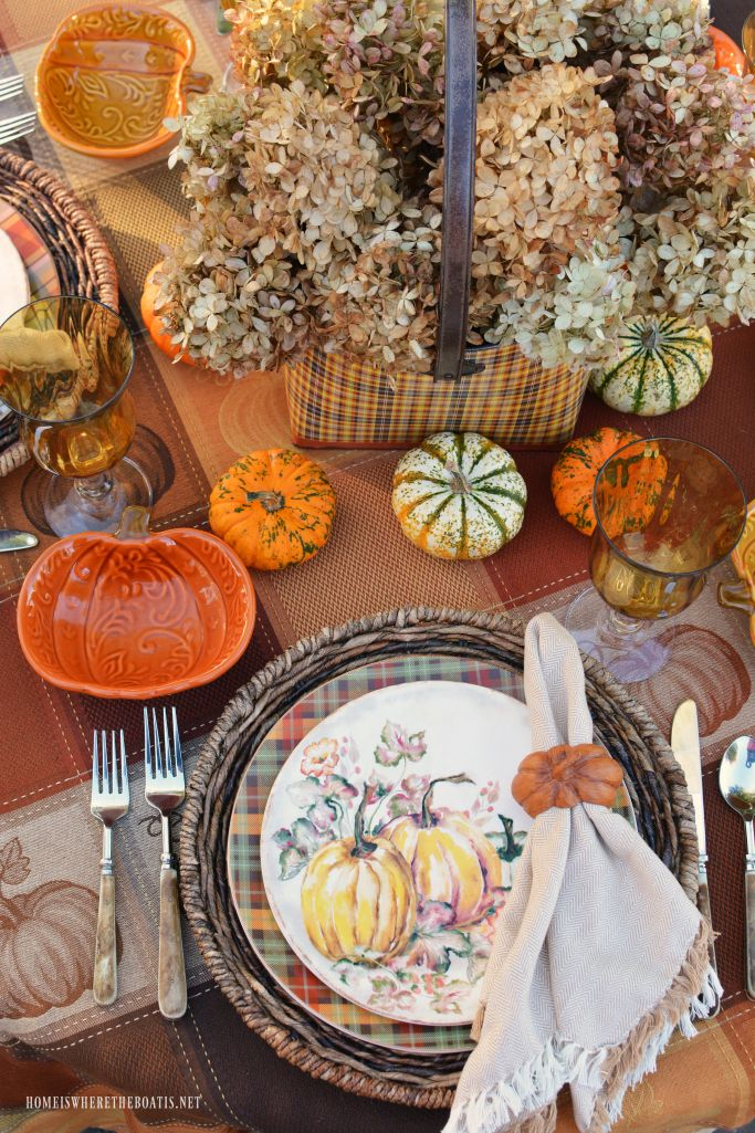 Pumpkins and Plaid Alfresco Fall Table | homeiswheretheboatis.net #fall #tablescape #pumpkins