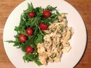 Scrambled Eggs with rocket and tomato