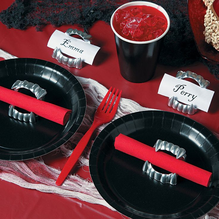 DIY Halloween Vampire Fang Napkin & Place Card Holders - OrientalTrading.com  If you weren't already thinking about having a Halloween party, you will now! This adorable idea will give your soirée that extra something that will make your guests scream for more! Whether vampire-themed or just plain creepy, create a dinner party your guests will want to sink their teeth into!