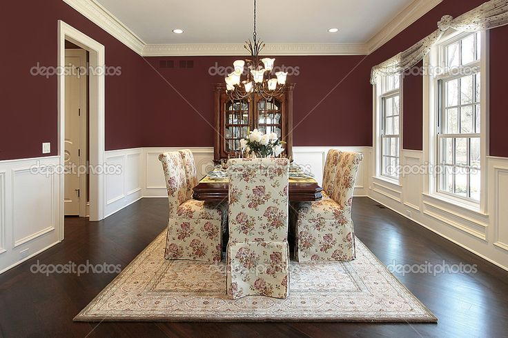 Dining room in luxury home with maroon walls