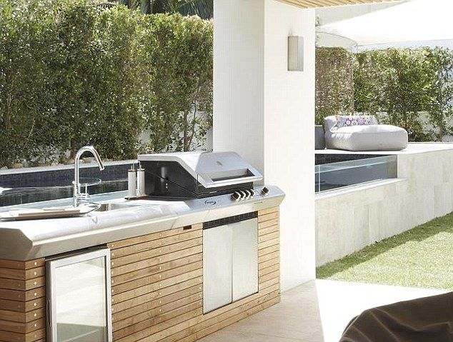 That's living! Outdoorsy types will enjoy using the al fresco kitchen and throwing a shrimp of the barbie
