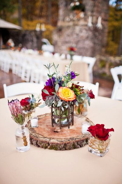 Roses, blue thistle, alstroemeria and eucalyptus for the perfectly rustic centerpiece.   Photography: CWF Photography - www.cwfphotography.org