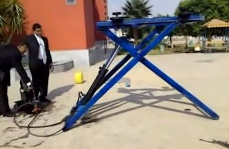 Portable Car Lift by Ahmed Hunter -- Homemade portable car lift constructed from channel, angle iron, bar stock, bronze bushings, rollers, and hydraulic cylinders. http://www.homemadetools.net/homemade-portable-car-lift